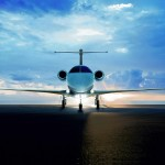 Phenom300--backview of plane on runway, wideshot