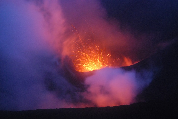 hot lava spewing out of one of the world's most active volcanoes located in Vanuatu