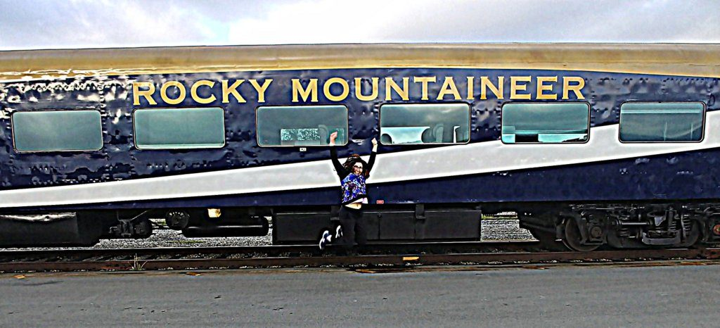 Lisa Niver is jumping for joy to get on the Rocky Mountaineer Train