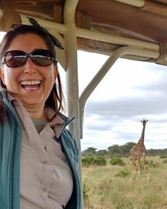 Lisa Niver in Tanzania with a giraffe