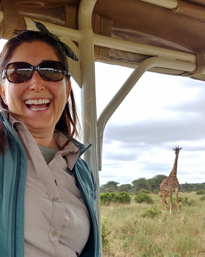 Lisa Niver in Tanzania with a giraffe