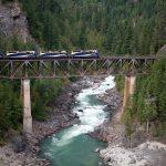 Rocky Mountaineer Train on bridge by Rocky Mountaineer