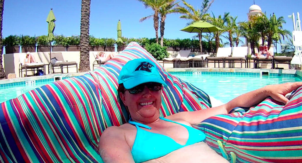 Lisa in a floating bean bag chair in the spa pool on the roof at Fairmont Scottsdale Princess