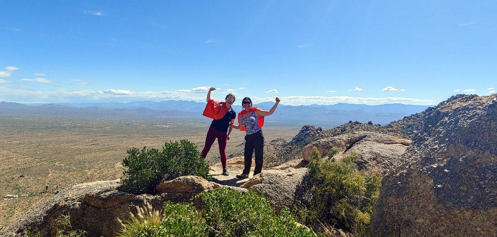 Lisa and Jen hiking with our Super Hero Capes at Tom's Thumb