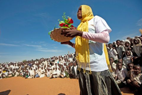"UN Photo/Albert González Farran A young woman at Zam Zam Camp for internally displaced in North Darfur, Sudan, participates in an event in 2012 which promoted the message, ""Together to Protect Women from Violence"", as part of the Sixteen Days of Activism against Gender Violence campaign, which takes place between the International Day for the Elimination of Violence against Women (25 November) and International Human Rights Day (10 December) to symbolically link the spirit of both events."
