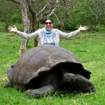 Lisa Niver with giant tortoise in Galapagos