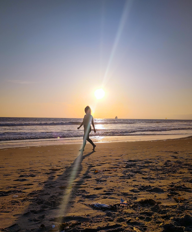 woman-on-beach-sunset-april-2-2021